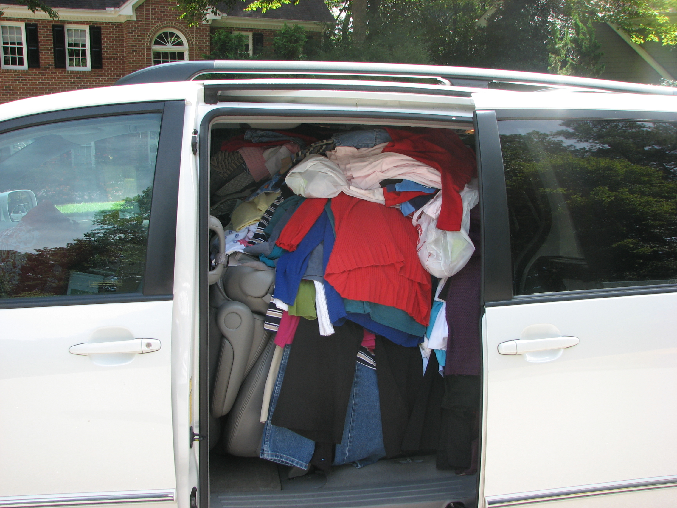A volunteer stuffs her van full and brings it to CPO when their truck can't fit it all!
